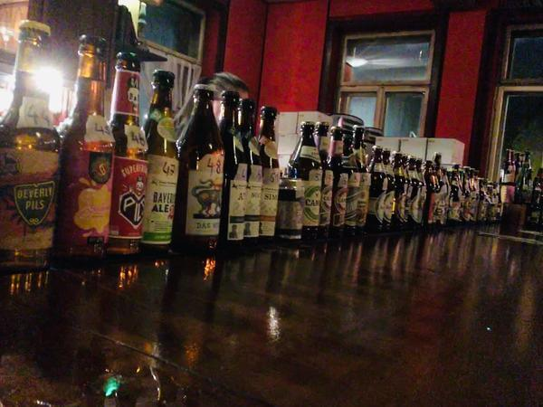 A line-up of craft beers in a bar